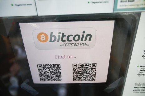 A Bitcoin logo is seen at the window of Nara Sushi, a restaurant that accepts Bitcoin, a form of digital currency, as payment in San Francis
