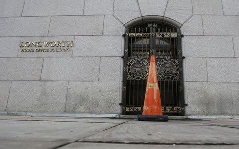 An orange cone blocks an entrance into the Longworth House Office Building on Capitol Hill in Washington after the U.S. Government shut down