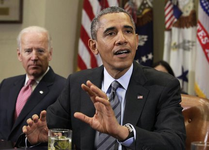 U.S. President Barack Obama (R) speaks next to Vice President Joe Biden during a meeting with business leaders to discuss immigration at the