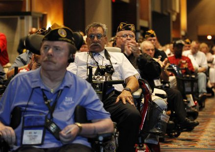 Disabled U.S. military veterans listen to President Barack Obama at the National Convention of Disabled American Veterans in Atlanta, August