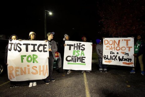 Demonstrators protest against the killing of 19-year-old Renisha McBride outside the Dearborn Heights Police Station in Dearborn Heights, Mi