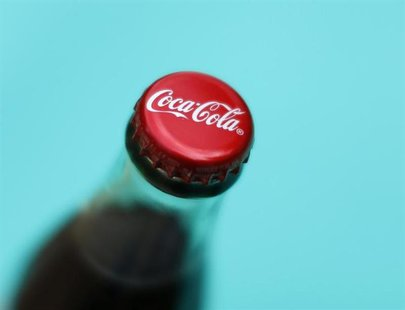 A bottle of Coca-Cola is shown in this photo illustration in Encinitas, California October 10, 2013. The Coca-Cola Company will report 3rd q