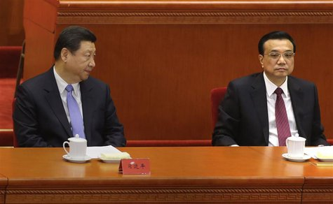 China's President Xi Jinping (L) looks at Premier Li Keqiang as they attend the opening ceremony of the 11th National Women's Congress at th