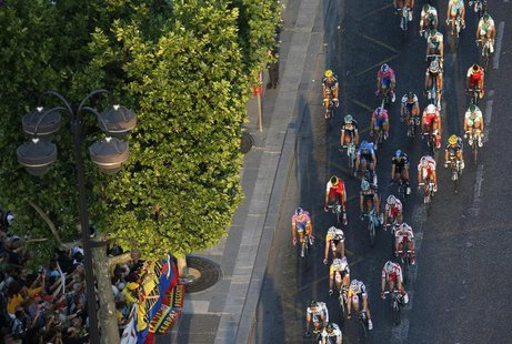 The pack of riders cycles on the Champs Elysees avenue during the 133.5km final stage of the centenary Tour de France cycling race from Vers