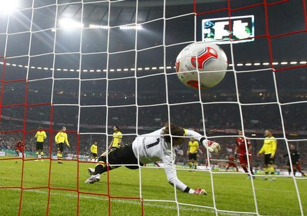 Borussia Dortmund's goalkeeper Roman Weidenfeller receives a goal by Bayern Munich's Arjen Robben during their German soccer cup, DFB Pokal,
