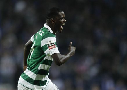 Sporting Lisboa's William Carvalho celebrates his goal against Porto during their Portuguese premier league soccer match at the Dragao stadi