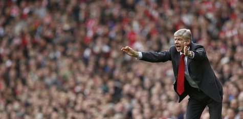 Arsenal manager Arsene Wenger reacts during their English Premier League soccer match against Tottenham Hotspur at the Emirates Stadium in L