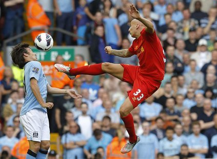 Liverpool's Jonjo Shelvey (R) is challenged by Manchester City's David Silva during their English Premier League soccer match at Anfield in