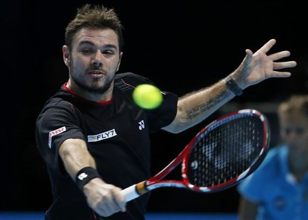 Stanislas Wawrinka of Switzerland hits a return during his men's singles tennis match against Rafael Nadal of Spain at the ATP World Tour Fi
