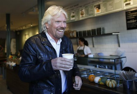 Sir Richard Branson, Founder of Virgin Group, buys a coffee before a seminar about the Virgin StartUp scheme for young entrepreneurs at Box