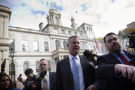 Incoming New York City Mayor Bill de Blasio exits City Hall after meeting with Mayor Michael Bloomberg in New York November 6, 2013. REUTERS