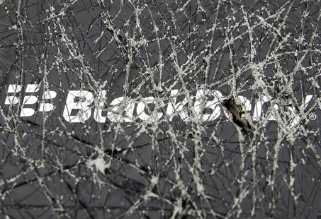 A Blackberry logo is seen through a cracked box in this photo illustration taken in the central Bosnian town of Zenica, September 24, 2013.