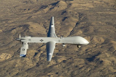 A U.S. Air Force MQ-1 Predator unmanned aerial vehicle assigned to the California Air National Guard's 163rd Reconnaissance Wing flies near