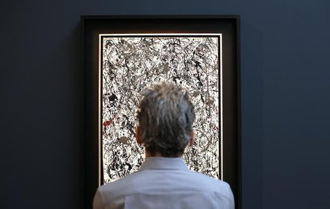 A visitor views American painter Jackson Pollock's 'Number 19,' oil and enamel on paper laid down on canvas, 1948 and estimated between $25-