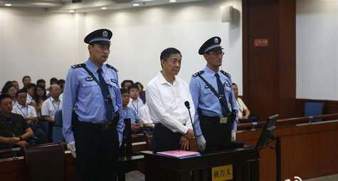 Disgraced Chinese politician Bo Xilai stands trial inside the court in Jinan, Shandong province, August 22, 2013, in this file photo release