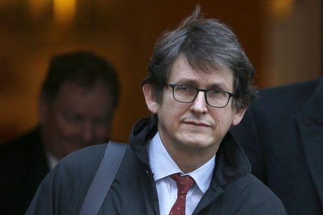 The editor of The Guardian Alan Rusbridger leaves Downing Street in London, December 4, 2012. REUTERS/Stefan Wermuth