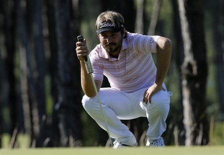 Victor Dubuisson of France looks at his putt on the fifth green during the final round of the inaugural Turkish Airlines Open in the southwe