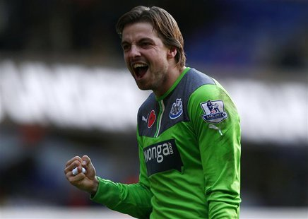 Newcastle United's goalkeeper Tim Krul celebrates after beating Tottenham Hotspur in their English Premier League soccer match at White Hart