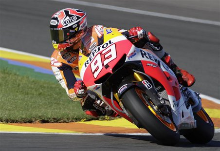 Honda MotoGP rider Marc Marquez of Spain races to win the pole position during the qualifying session ahead of the Valencia Motorcycle Grand