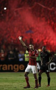 Mohamed Aboutrika of Egypt's Al-Ahli waves to fans after he was substituted during their African Champions League final soccer match against