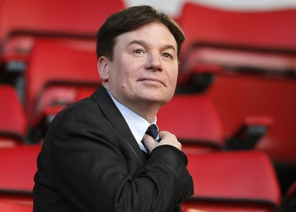 Actor Mike Myers sits in the stands before Liverpool faces Fulham in their English Premier League soccer match at Anfield in Liverpool, nort