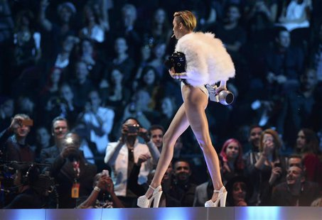 Singer Miley Cyrus walks on stage during the 2013 MTV Europe Music Awards at the Ziggo Dome in Amsterdam November 10, 2013. REUTERS/Remko De