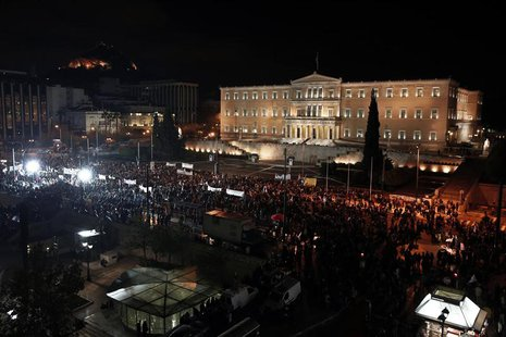Supporters of the leftist main opposition Syriza party take part in an anti-government rally in front of the parliament in Athens November 1