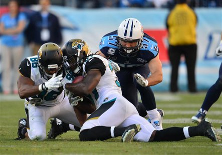 Nov 10, 2013; Nashville, TN, USA; Jacksonville Jaguars safety Johnathan Cyprien (37) recovers an onside kick against the Tennessee Titans du