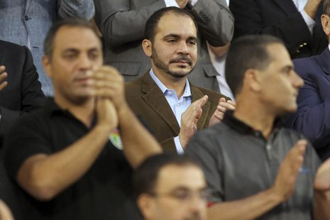 Jordan's Prince Ali bin Al-Hussein (C) attends Jordan's 2014 World Cup qualifying soccer match against Uzbekistan at King Abdullah stadium i