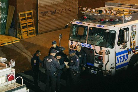New York Police Department Officers depart a multiple shooting crime scene on Maujer Street in the Brooklyn borough of New York, November 11
