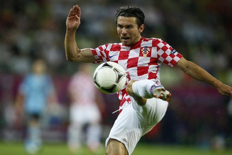 Croatia's Danijel Pranjic shoots the ball during their Group C Euro 2012 soccer match against Spain at the PGE Arena in Gdansk June 18, 2012