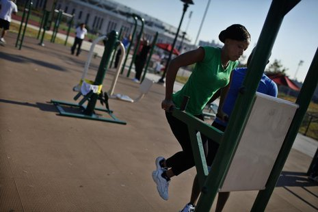 A woman works out in an outdoor exercise area at Macombs Dam Park in the Bronx section of New York City, September 13, 2012. REUTERS/Mike Se