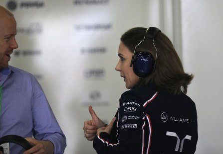 Williams Formula One acting team principal Claire Williams speaks to an unidentified man (L) during the second practice session of the Chine