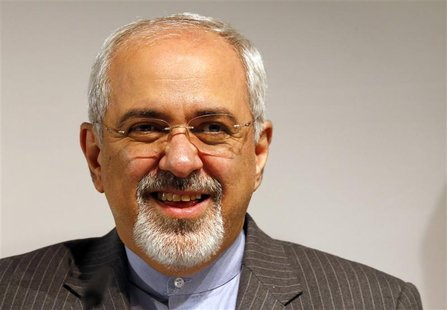 Iranian Foreign Minister Mohammad Javad Zarif smiles during a news conference after nuclear talks at the United Nations European headquarter