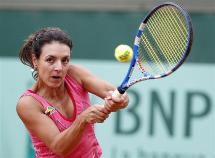 Nuria Llagostera Vives of Spain returns the ball to Anastasia Pavlyuchenkova of Russia during the French Open tennis tournament at the Rolan