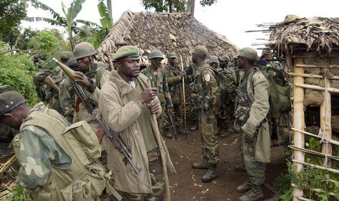 Congolese soldiers gather for a military brief after M23 rebel fighters surrendered in Chanzo village in the Rutshuru territory near the eas