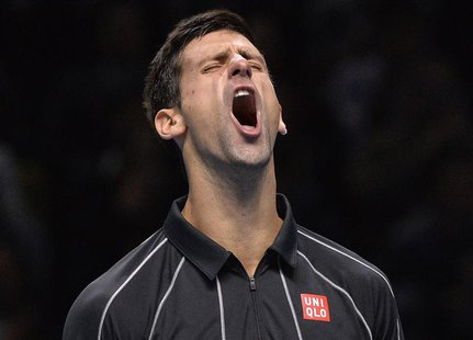 Novak Djokovic of Serbia reacts after breaking the serve of Rafael Nadal of Spain during their men's final singles tennis match at the ATP W
