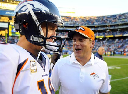 San Diego, CA, USA; Denver Broncos quarterback Peyton Manning (18) celebrates with Denver Broncos interim head coach Jack Del Rio following