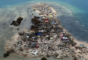 An aerial view of a coastal town, devastated by super Typhoon Haiyan, in Samar province in central Philippines November 11, 2013. Dazed survivors of super Typhoon Haiyan that swept through the central Philippines killing an estimated 10,000 people begged for help and scavenged for food, water and medicine on Monday, threatening to overwhelm military and rescue resources. REUTERS/Erik De Castro