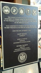 Plaque presented to Green Bay Packers organization for dedication to veterans. (Photo by: WTAQ Reporter Jeff Flynt)