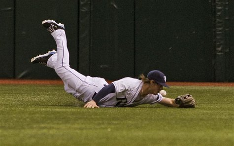 Tampa Bay Rays right fielder Wil Myers comes up short as he dives for Texas Rangers' Elvis Andrus' single during the first inning of their M