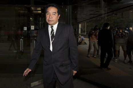 Birmingham City president Carson Yeung Ka Sing leaves the district court in Hong Kong October 15,2013. Yeung has defended himself in the Dis