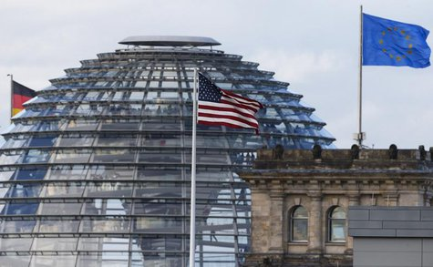 The flag on the U.S. embassy is pictured next to the Reichstag building, seat of the German lower house of parliament Bundestag, in Berlin O