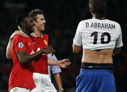 Manchester United's Danny Welbeck (L) celebrates scoring a goal with Michael Carrick against FC Basel during their Champions League Group C