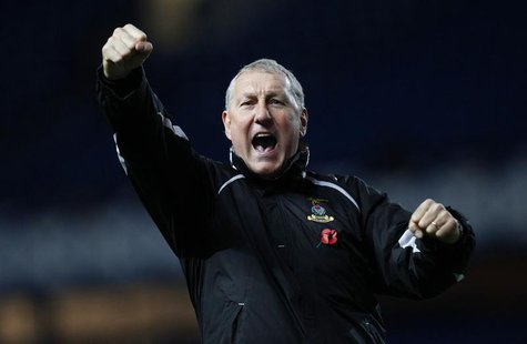 Inverness Caledonian Thistle manager Terry Butcher celebrates after their Scottish League Cup soccer match victory over Rangers at Ibrox Sta