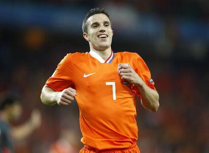 Netherlands' Robin van Persie celebrates after their Group C Euro 2008 soccer match victory over Romania at the Stade de Suisse stadium in B
