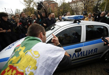 Protesters try to block a police vehicle during a demonstration near the parliament in central Sofia November 12, 2013. REUTERS/Stoyan Nenov