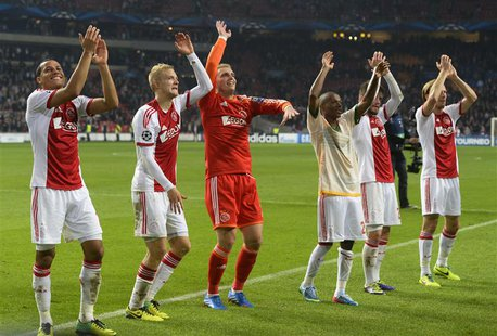 Ajax Amsterdam's players celebrate their victory against Celtic after their Champions League soccer match at Amsterdam Arena November 6, 201
