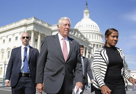 House Minority Whip Steny Hoyer (D-MD) (2nd L) arrives for a news conference at the U.S. Capitol in Washington, October 23, 2013. REUTERS/Jo