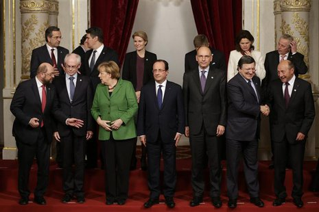 French President Francois Hollande (C) and EU head of states including German Chancellor Angela Merkel (first row,3rdL), Italian Prime Minis
